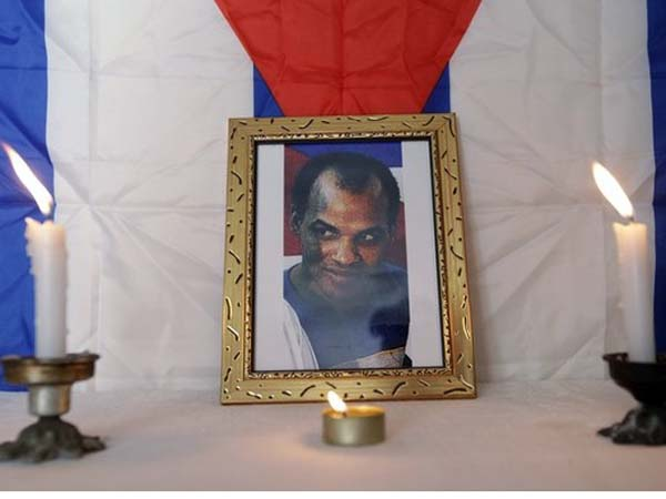 Photograph of Zapata sits on altar in home of Cuban dissident to remember first anniversary of Zapata's death, in Havana
